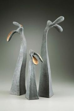 SHARON STELTER:  Using a variety of hand building techniques such as hollow form slab and coil building, along with heavily textured surfaces builds interest in the work. The pieces are then finished with iron oxide washes and colored glazes