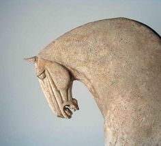Tang Dynasty Pottery Horse.  Originating from the Fongxian area of Shangxi Province is this magnificent & rare Tang Dynasty (618-906 A.D.) unglazed pottery horse. via Ancient East Antiques