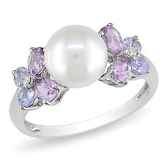 Beautiful pearl and amethyst ring.. amethyst for cody's February birthstone.. pearl for mine in June. :) perfect