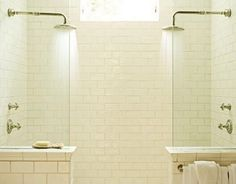 Double shower with white brick tiles