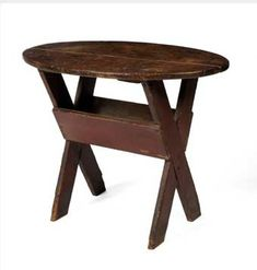 SMALL RED-PAINTED SAWBUCK TABLE WITH OVAL TOP