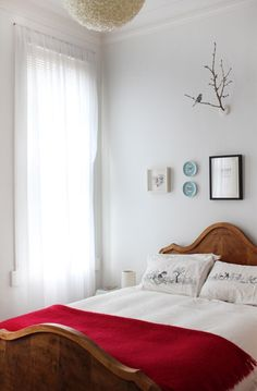 Branch above bed and minimal, bunched wall objects. Could also use Jill + David's wall branch idea...