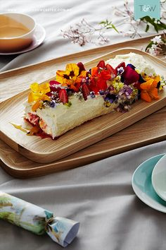 Jono Fleming shares a family tradition involving sugar, fruit and a dash of creativity - rolled pavlova with edible flowers.