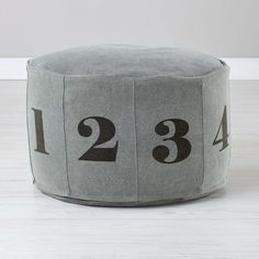 Shop Numbers Pouf (Grey).  Adorned with big, bold numerals, our canvas Numbers Pouf is a comfy seat and a math lesson all in one.  Available in Natural or Grey.