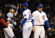 Chicago Cubs' Willson Contreras, left, Aroldis Chapman and Anthony Rizzo celebrate after Game 5 of the Major League Baseball World Series against the Cleveland Indians, Sunday, Oct. 30, 2016, in Chicago. The Cubs won 3-2 as the Indians lead the series 3-2. (AP Photo/Nam Y. Huh)