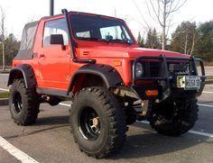 Beautiful Suzuki Samurai red with the bushwacker fender flares. Nice setup.