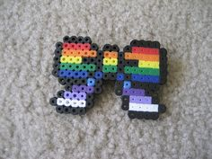 Love rainbows? Love to show the world you love rainbows? Just think this one is cool? Then this bow is for you. Unlike my other bows, this one does not have the small dot in the last row that is the same color as the fill color, the outline is all black.