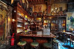 """Int Aepjen  Tony visits one of the oldest bars in Amsterdam, Int Aejpjen (""""in the ape""""). It was originally an old sailor bar and, as the story goes, when a sailor couldn't pay for his room he would give them a monkey he had collected from his travels. Anthony Bourdain, The Layover"""