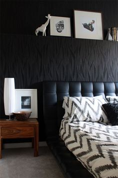 I LOVE the wallpaper, the headboard and especially the displaced wall - you could hang a real mofo of a picture in the upper part