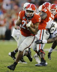 Georgia Football - Bulldogs Photos - ESPN THENS, GA - OCTOBER 04: Running back Nick Chubb #27 of the Georgia Bulldogs runs for a fourth-quarter touchdown during the game against the Vanderbilt Commodores at Sanford Stadium on October 4, 2014 in Athens, Georgia. (Photo by Mike Zarrilli/Getty Images)