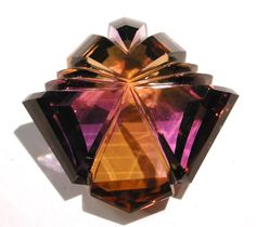 Ametrine - Lek Ho, of Bangkok, Thailand, faceted and carved this 202 carat Ametrine into an interesting shape using a special machine.