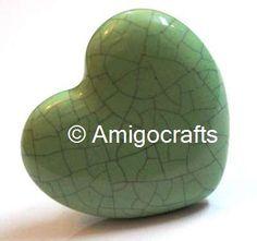 http://www.amigocrafts.com/ProductDetail.aspx?m=0&c=0&sc=22&q=1153&tag=Olive%20Green%20Heart%20Crackle%20Knob