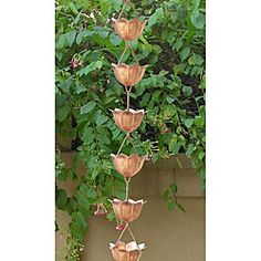 @Overstock.com - Creativity and functionality are combined to create this one of a kind rain chain The beautifully crafted Lotus petals adds visual appeal and beauty to any outdoor settingRain chain measures 8.5 feet long http://www.overstock.com/Home-Garden/Lotus-Copper-Rain-Chain/4048701/product.html?CID=214117 $89.99