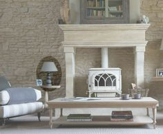 Surround this beautiful cream log burner with a timber fireplace to make it the focal point in the room...