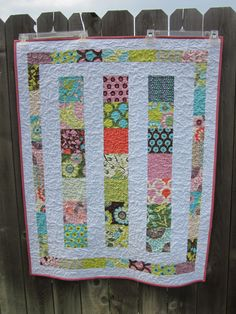 Charm pack quilt made with the Moda Sugar Pop line.  I used the Moda Bake Shop Line Dance Baby Quilt tutorial.