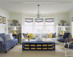 Relaxed blue and yellow living room.