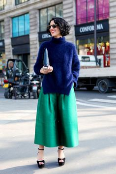 Yasmin Sewell made oversized culottes look glam. This is such a colorful outfit and the bold lips and carefully curled bob add a feminine touch. She wasn't afraid to add some major sunnier to the equation.