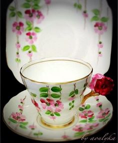 Floral handle tea cup trio.....