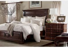 the warwick bed by ethan allen is a masculine style with strong moldings and recessed panels it is softened by the circular motif on the headboard and