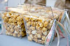 Like this idea. Clear containers of pop corn for party favors.                                                                                                                                                                                 More
