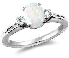 this is the opal ring style that I really love. opals are my favorite stone as well;)