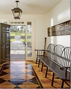 entry with lantern and windsor bench
