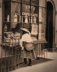 A picture simply entitled, The Old Sweet Shop. Probably Victorian London. The Fry's Chocolate window advertising was white enameled lettering.
