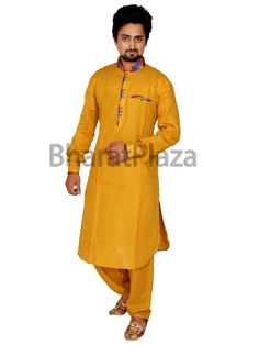 Fashionable mustard color linen kurta with contrast patches on collar. Item code: SKB1022P http://www.bharatplaza.com/new-arrivals/kurta-pyjamas.html