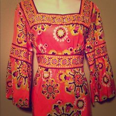 Trina Turk top size 10 Measures 19 inches from arm pit to arm pit, measures 28 Inches in length Trina Turk Tops Blouses