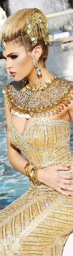 Gold Beauty! I love that the styling is so amazing that the headdress is an inexpensive coin necklace and the bid is an inexpensive beaded knock off. But with such a beautiful model and dress the accessories just pop!! I love this imagery!