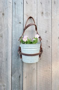 Hanging Flower Planter Pot Vintage Galvanized Bucket Leather Horse Bridle Garden Decor Rustic Ranch Farmhouse Barn by RelicsAndRhinestones on Etsy https://www.etsy.com/listing/238126021/hanging-flower-planter-pot-vintage