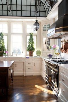 Love the planters, the greens and whites of this kitchen is beautiful