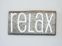 "Items similar to Reclaimed Barnwood Wall Art Hand-Painted Wood Sign Rustic Decor - ""Relax"" on Etsy Barn Wood Signs, Painted Wood Signs, Reclaimed Barn Wood, Massage Room Decor, Esthetics Room, Barn Wood Projects, Pallet Art, Pallet Ideas, Family Room Decorating"