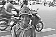 Not to busy to stop for a pic on the busy streets in Hanoi, Ha Noi, Vietnam. On location for Chefs Run Wild
