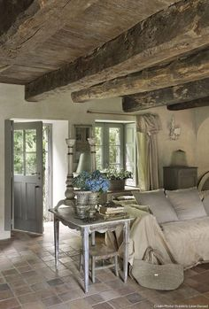 Too many fussy decor items on the side table but otherwise I love the cool neutral palette and the stone and beams.