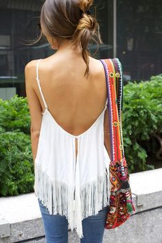 Open back white blouse, jeans and Aztec print bag. Spring/summer ideas 2015.