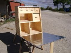 Chuck box; I like the work surface and the leg support under the work surface.