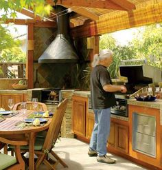 The joy of barbecuing shouldn't be limited to the summer months. A covered pavilion and custom wood- and gas-burning grills allow these Napa, California, homeowners to entertain outdoors year-round.
