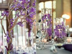Purple centerpieces, wisterias in water with floating candles