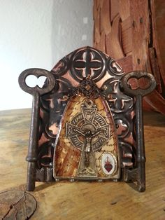 A tiny shrine mixed media shrine with Celtic Cross, jewelry findings and antique keys.