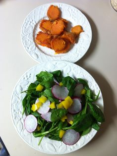 Lightly sautéed yams  in coconut oil and a spinach salad with radishes and yellow peppers. Lemon Parsley dressing on top.