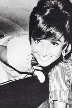 Audrey Hepburn in the car while heading toThe Cinema Festivalin Taormina, on August 9th 1965.