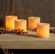 Restoration Hardware Battery-Operated Wax Flameless Votives Ivory - set of 4. Enclosed in a layer of paraffin wax, these indoor votives have the soft texture and flickering ambience of real candles. Yet they're battery-operated, flameless and free of soot and smoke.