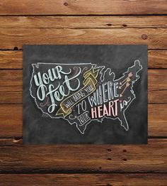 """Artistically rendered in chalk, this map art print is an adorable reminder that no matter the path, you're right where you're supposed to be. The original chalkboard artwork is lettered in a mix of script and blocky styles, the words, """"Your feet will bring you to where your heart is,"""" decorated with arrows, hearts and banners inside of a U.S. map."""
