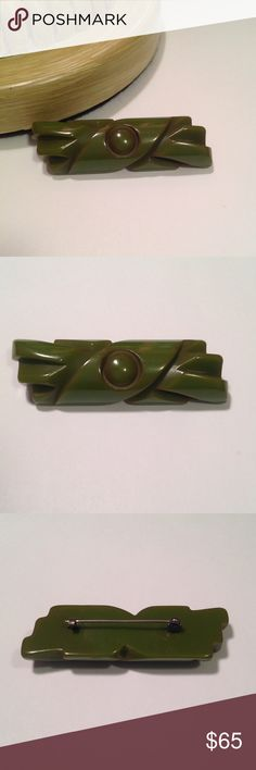 "Vintage Bakelite Brooch Vintage bar style carved Bakelite brooch green in color with highlights of reddish brown color through out it. It has the ""C"" style closure indicative of time period. Measures 2 3/4"" long 3/4"" wide. Good vintage condition tested with simichrome Vintage Jewelry Brooches"