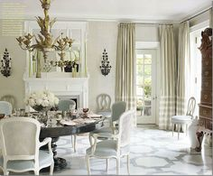 traditional dining room with pedestal table painted black