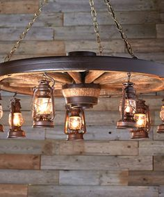 Wagon Wheel Lantern Chandelier Wagon Wheel Lantern Chandelier: Featuring a reproduction wagon wheel and seven hanging lanterns, the Large Wagon Wheel Chandelier with Rustic Lanterns is perfectly suited to your Old West home.