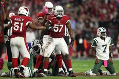 Monday Night Football: Jets vs. Cardinals:     October 17, 2016  -  28-03, Cardinals  -     Outside linebacker Alex Okafor of the Arizona Cardinals celebrates with Kevin Minter after a sack on quarterback Geno Smith of the New York Jets during the fourth quarter of the NFL game at the University of Phoenix Stadium on Oct. 17, 2016 in Glendale, Ariz.