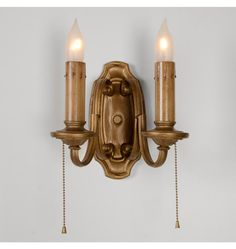 "2-Light Colonial Revival Candle Sconce, c1920""A great example of how even the most common Colonial Revival fixtures of the 1910s and 1920s had impeccable taste and easily accessible refinement, this 2-candle wall bracket or sconce features a richly antiqued gilt finish, with original pull-chain sockets and lightly stained candle covers."""