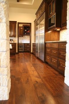 "Walnut  Visit Store »  Hardwood floors in the kitchen is a fast growing trend. This 8"" wide plank engineered walnut is a great look in this style of home."